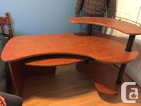 This is an office desk with interesting curves -