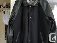 Customized black bomber style jacket. Same kind that