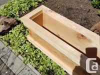 This cedar planter box is perfect for along side a