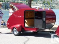 This is a factory made teardrop trailer from a company