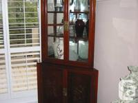 This lovely Curio Display Cabinet is in solid rosewood