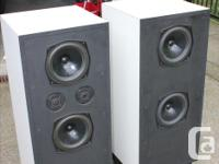 Speakers front and back of cabinet with tweeter that