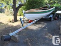 This is a beautiful custom make 14ft wooden dory. The
