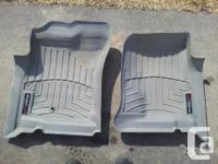 "2 front ""Weather Tech"" truck mats custom molded to fit"