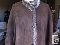 Brown Shearling and suede long coat by Dominque