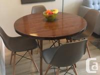 Unique, custom table and chairs set. Eames Chairs