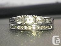 Amazing custom white gold wedding set. A full carat of