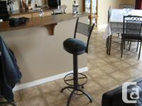 Custom built wrought iron and glass furniture.