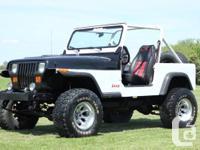 This personalized V8 1989 YJ Jeep Wrangler coupe