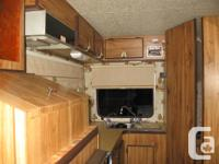 1981 Frontier approx 18ft. has stove with oven, fridge