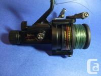 Older Daiwa spinning reel in good working condition. No