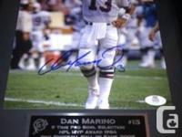 This is an original autographed photo by Dan Marino