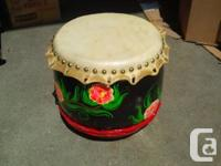 This is a chinese wooden cowhide drum for lion dance.