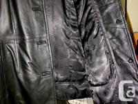 Danier women's leather jacket with removable lining.