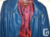 Danier Leather Woman's Jacket. Teale/blue colour Size