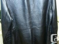 Selling a new condition Danier Black leather jacket.