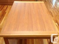 Nice danish teak dining table with 2 leafs. Dimensions