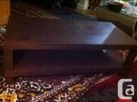 Practically new living room/ coffee table Has two