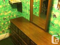 Dark brown dresser and mirror. Cabinet is in excellent