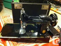 This is an impressive black 221 Singer featherweight