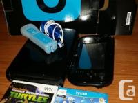 Offering a black Nintendo Wii U which has 32 gb of