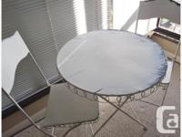 Deck or Sunroom Table w/ 2 Chairs - $80. You may want