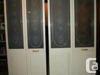 2 elegant Bifold Doors (folding doors). Upper half is