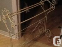Decorative quilt rack made of solid metal or wrought