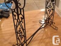 Decorative quilt rack made of solid wrought iron. It