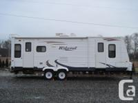 Fresh 2009 Hideout Travel trailer. Personal room with