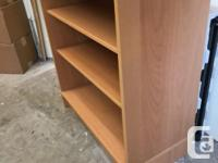 Very well constructed solid wood book case. Quite deep.