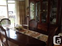 Beautiful cherrywood dining room table with 2 inserts,