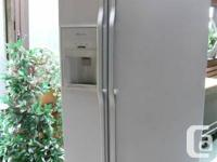 White textured SideXSide Jenn-Air Refridgerator, with