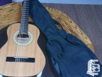 Selling a Denver 3/4 acoustic guitar. It has 3 metal