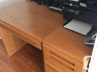 A nice solid desk w/ drawer along w/ a matching filing