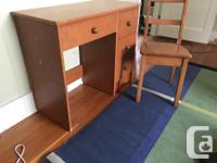 Solid wood desk, comes with chair. Has four drawers,