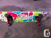 DGK skate board with pink lip tracks and wheels Barely