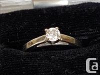 A beautiful brand new engagement ring, size 7. Diamond