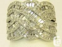 Stunning Diamond Ring. 1.5 ct diamonds. 10k white gold.