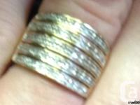 Diamond Ring with 5 bands of 9 diamonds. Giving you 45