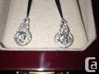 Real diamond earings. Never been worn. 0.087CT Canadian
