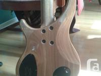 This stunning boutique bass is made of walnut with a