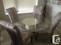 "54"" round glass leading table + 6 chairs. Less compared"