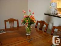 """Moving. Superb walnut table and 6 chairs. Table is 42"""""""
