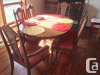 Elegant timber dining-room table with 6 coordinating