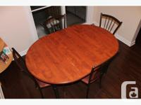 I am selling a Dining Set with table and four chairs.