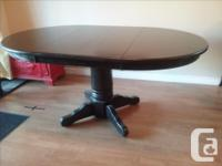 Refinished table in espresso stain. Has 2 leafs to