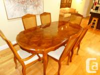 This is a beautiful dining room set featuring a table,