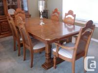 Set includes table, 4 regular chairs, 2 captain chairs,