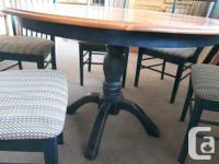 Wood dining room table set with 5 chairs, one is an arm